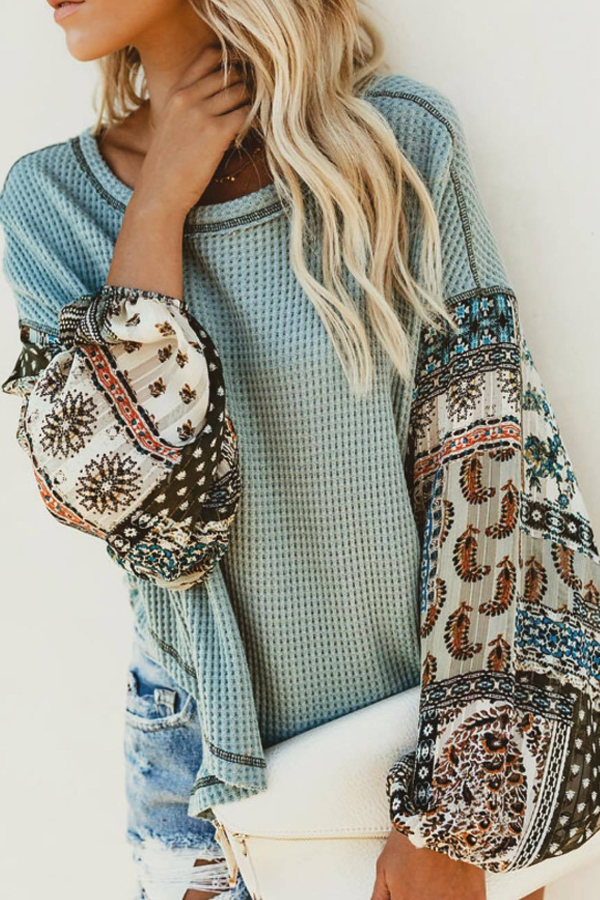 Boho light sweater with patterned sleeves