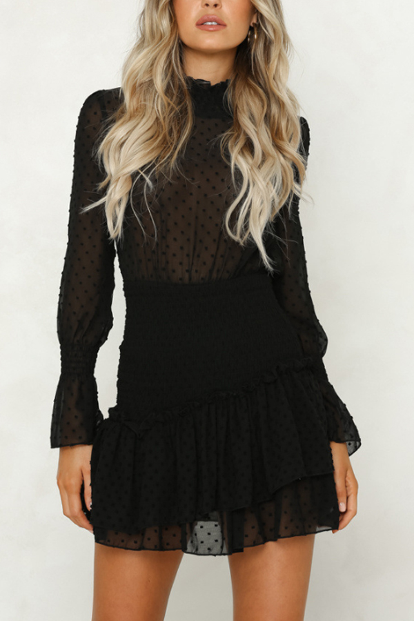 Little black dress with polka dot lace and long sleeves