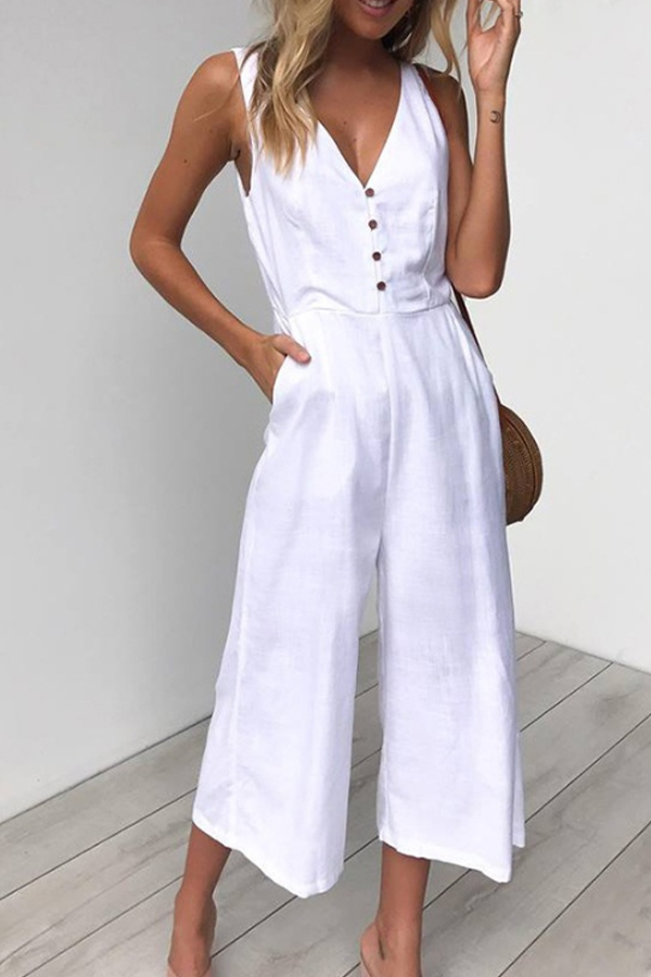 Lovely sleeveless white jumpsuit with flared legs above the ankle