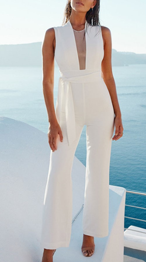 White jumpsuit with belt and transparency in the neckline