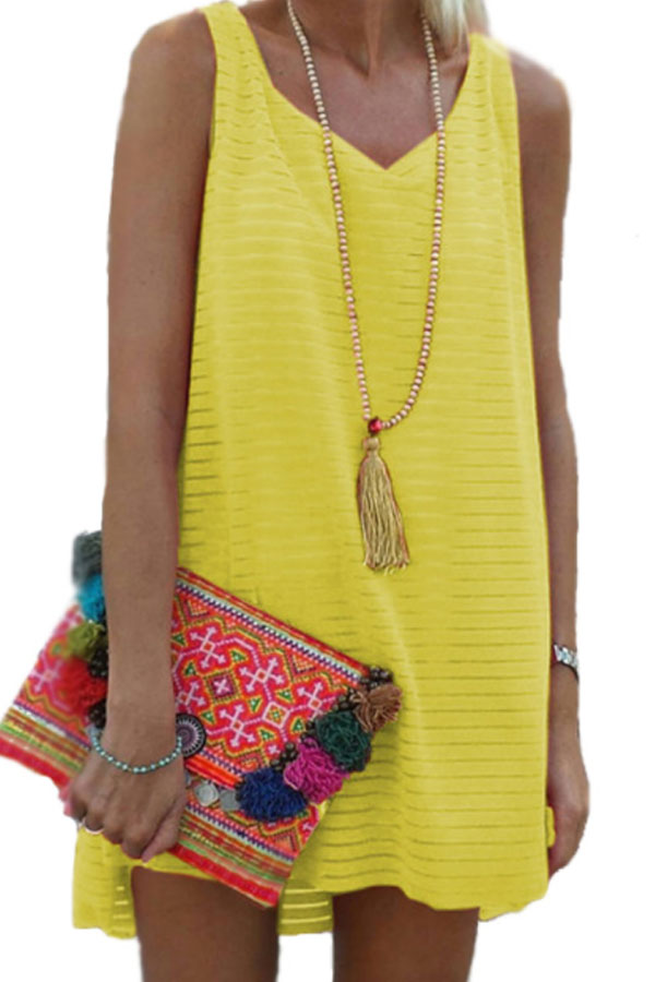 very cute summer outfit - casual dress with asymmetric hem - boho necklace - pompons clutch