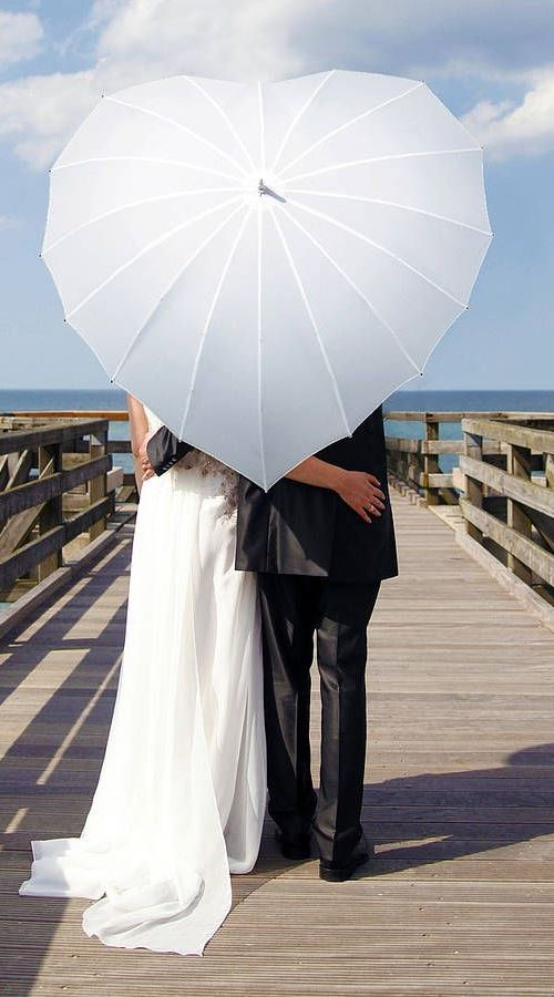 Heart shaped Wedding Umbrellas - the perfect umbrella for you wedding day. Look great in wedding photos!