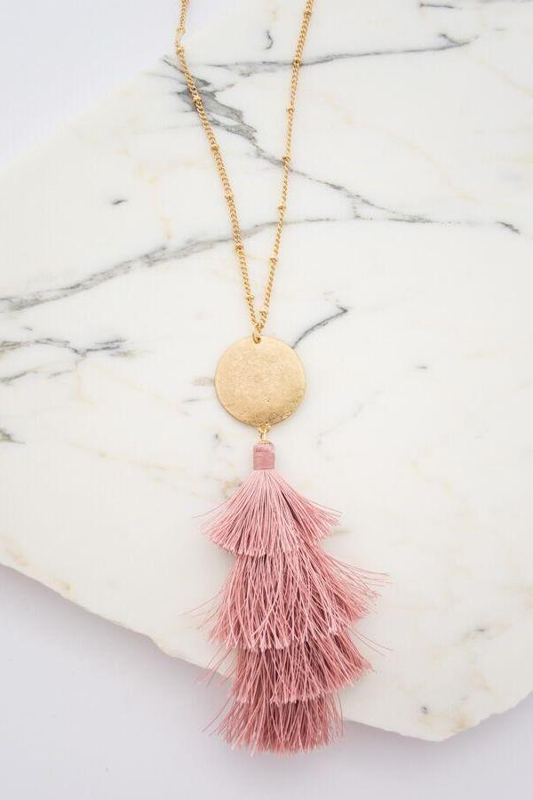 This statement pink tassel necklace is the perfect accessory to any outfit!