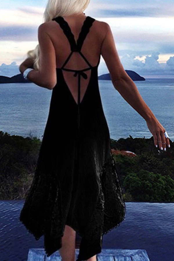 black dress with irregular flared skirt and a sexy back