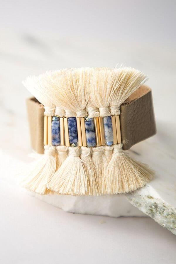 exotic tassel bracelet with blue stones, gold touches, and a natural band you'll sure be in love.