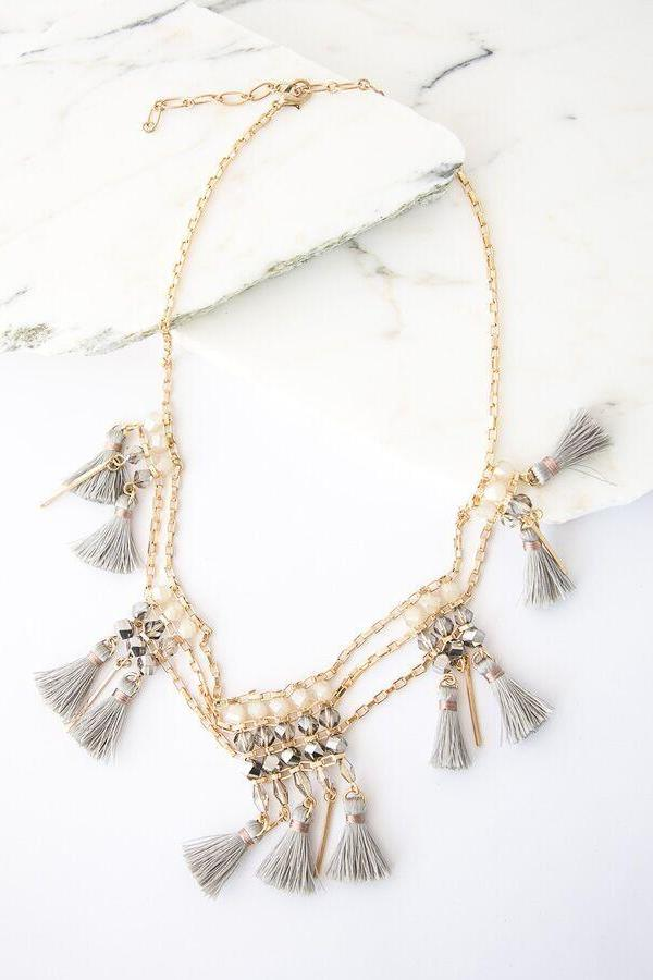 i love this tassel beaded necklace in grey and gold !