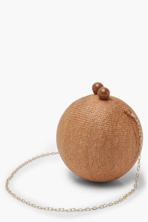 Add attitude with this straw sphere clutch bag
