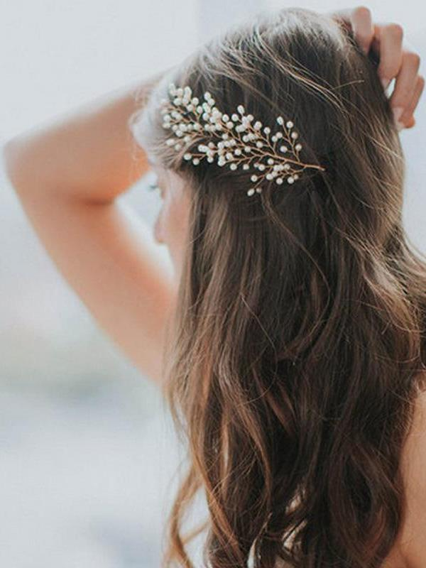 I love this bridal hair look with a gorgeous leaves headdress