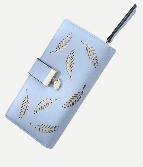beautiful light blue fold over purse with leaf detail in golden