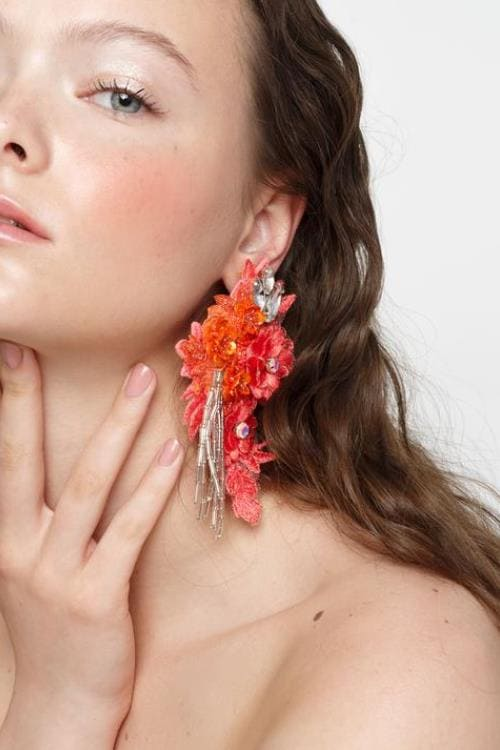 Clip-on flower earrings embelished with crystals, sequins and beads
