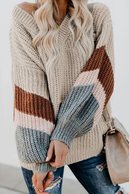 Loose thick sweater in beige with striped sleeves