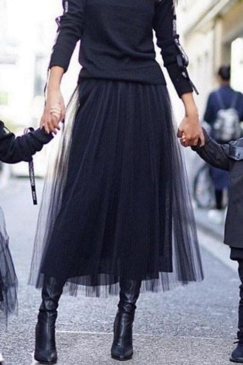 Black tulle over skirt with high boots