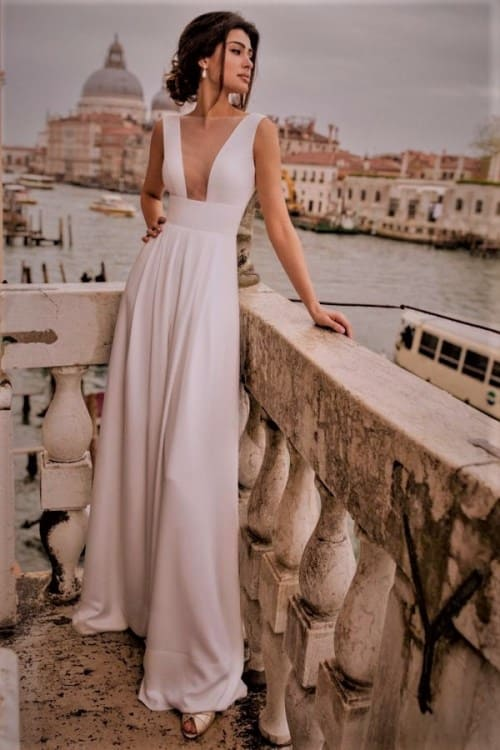 Gorgeous Wedding Jumpsuit with deep neckline cut and transparent fabric