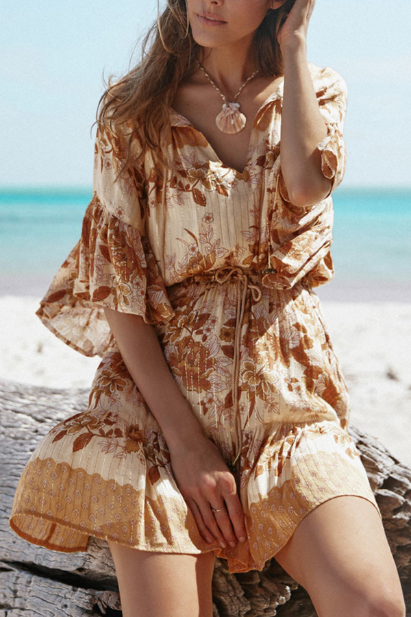 Bohemian beach mini dress with floral print and bell sleeves